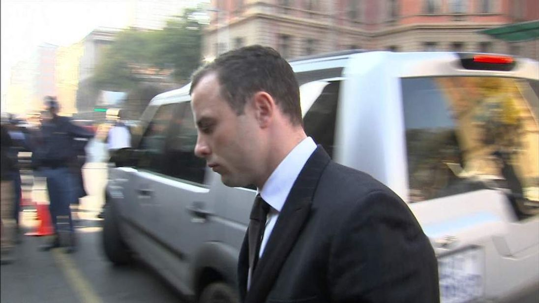Oscar Pistorius arrives at the courthouse in Pretoria, South Africa
