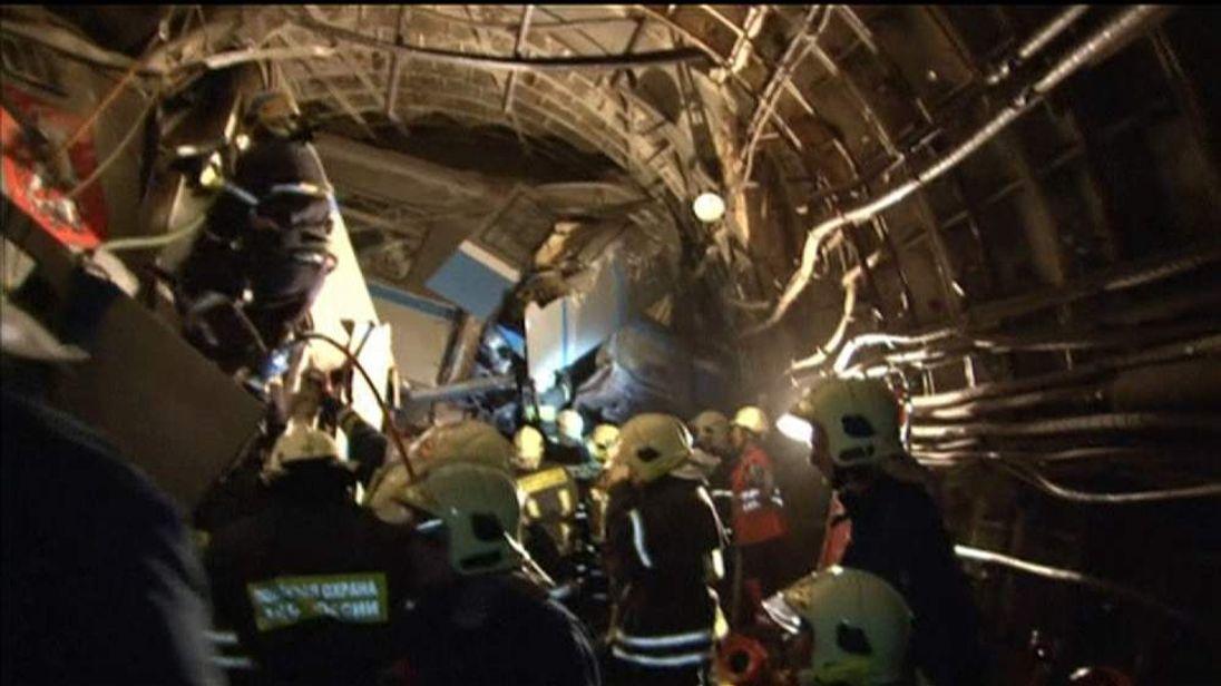 Emergency crews struggle to reach injured in Moscow metro crash