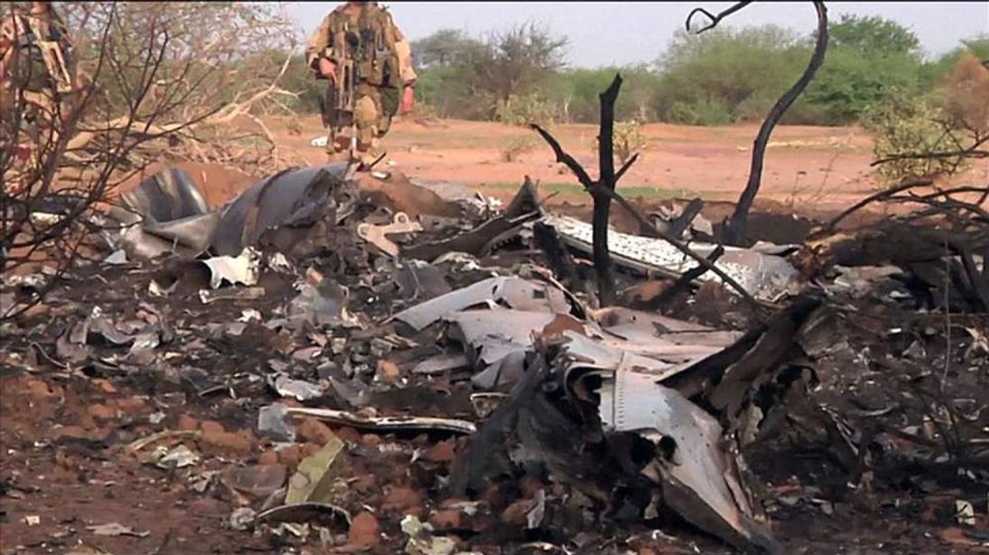 A French soldier guards the crash scene of Air Algerie aircraft