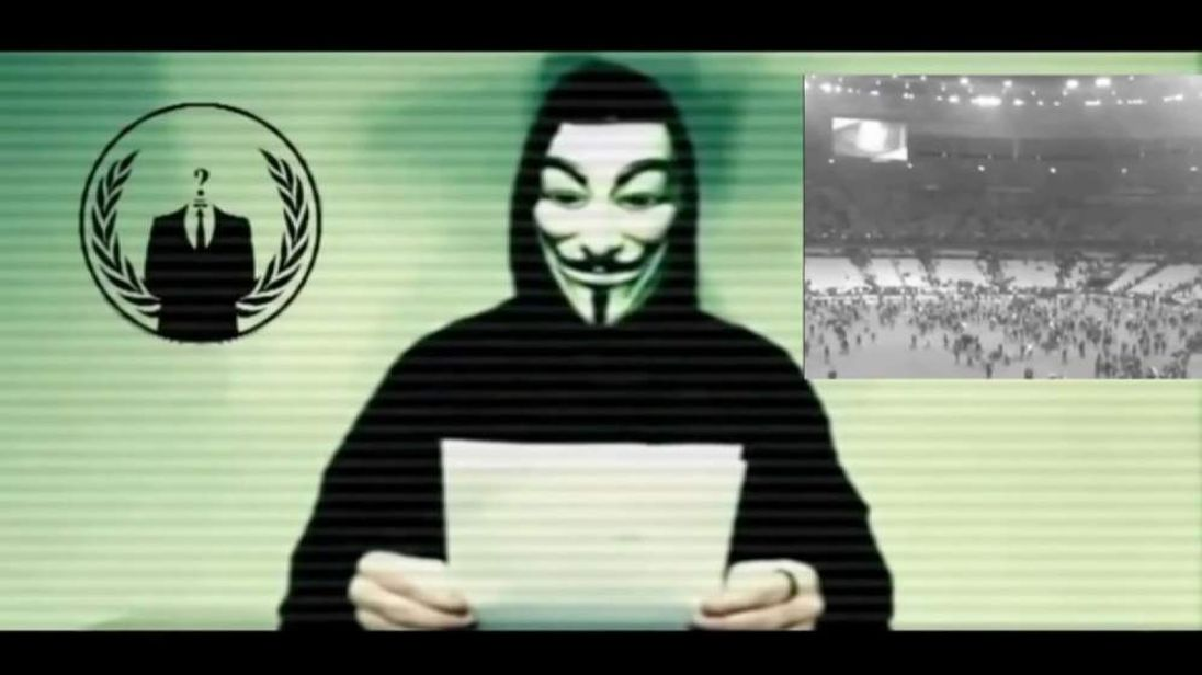 A member of the hacker group Anonymous reads a message to Islamic State after the terrorist attacks in Paris