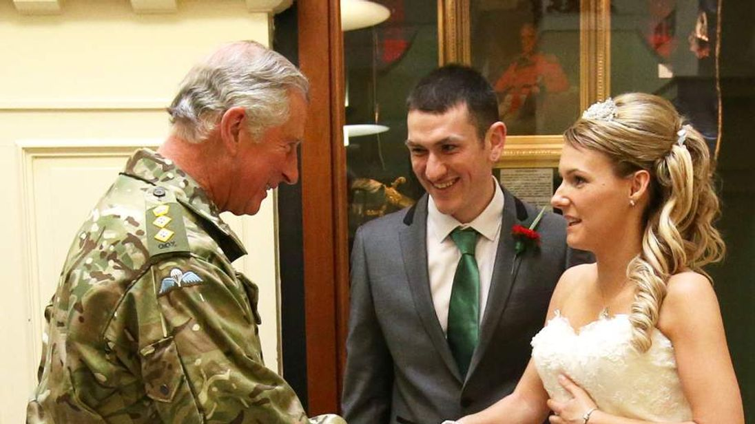Prince Charles joins wedding photos of newlyweds
