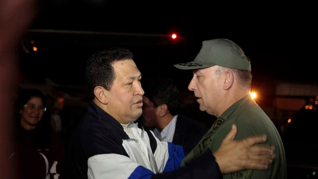 Venezuela's President Chavez talks to Venezuela's Defense Minister Admiral Molero, upon his arrival from Cuba, at Simon Bolivar airport in Caracas