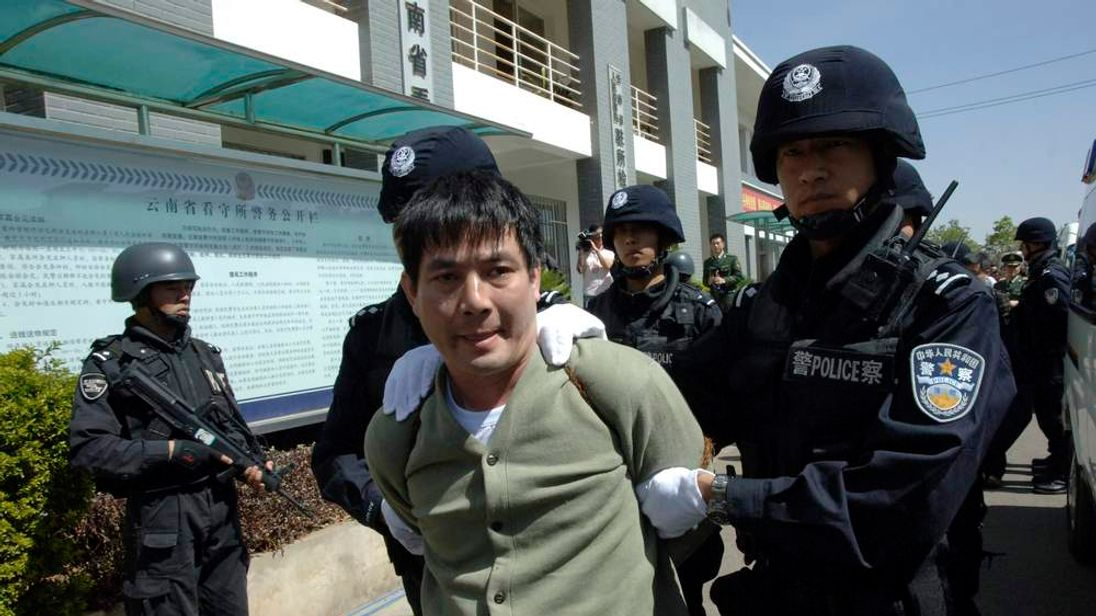 Principal suspect Naw Kham leaves the detention centre for execution in Kunming