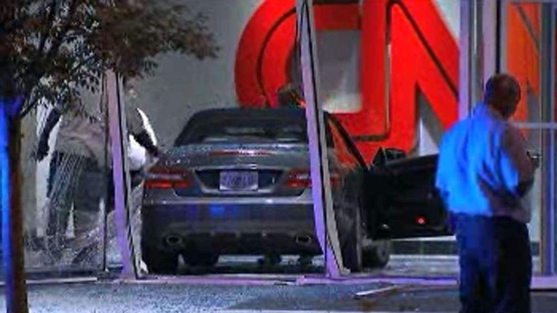 130614 $$ Car Smashes Through Lobby Of CNN Headquarters