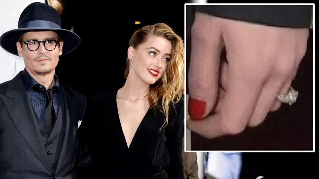 Actor Johnny Depp (L) and his fiancee actress Amber Heard