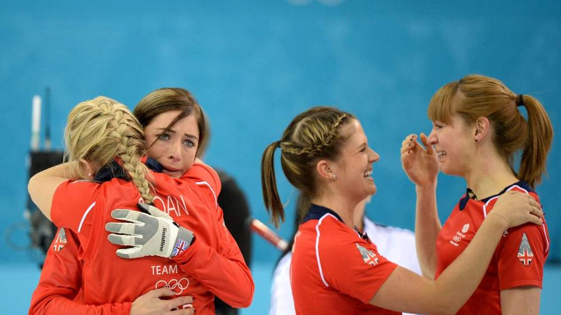 Great Britain's Anna Sloan, Eve Muirhead, Vicki Adams and Claire Hamilton celebrate after winning the Women's Curling Bronze Medal