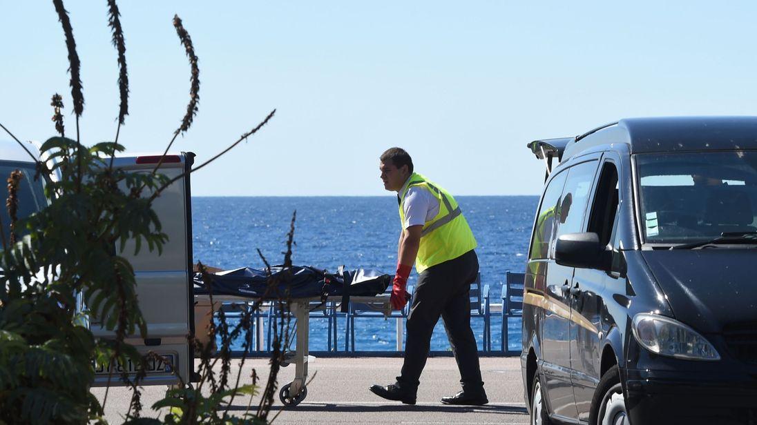 A forensic expert evacuates a dead body on the Promenade des Anglais.