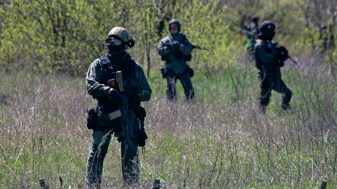 Ukrainian soldiers stand guard near the Kramatorsk airport in eastern Ukraine