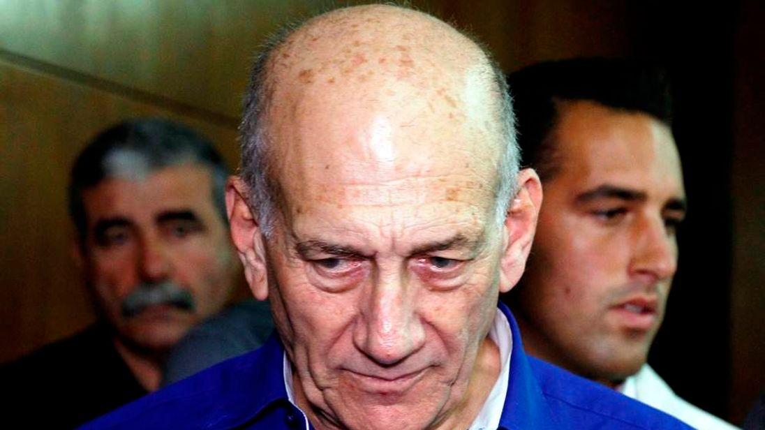 Former Israeli Prime Minister Ehud Olmert arrives at the Tel Aviv District