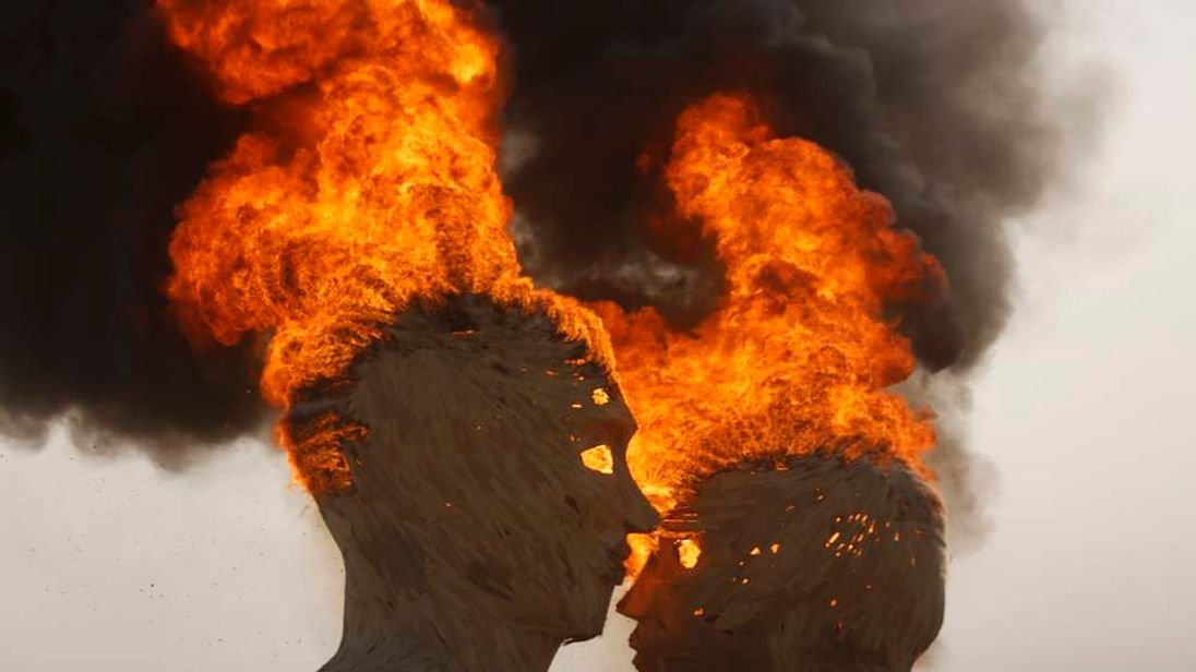 "The art installation Embrace burns during the Burning Man 2014 ""Caravansary"" arts and music festival in the Black Rock Desert of Nevada"