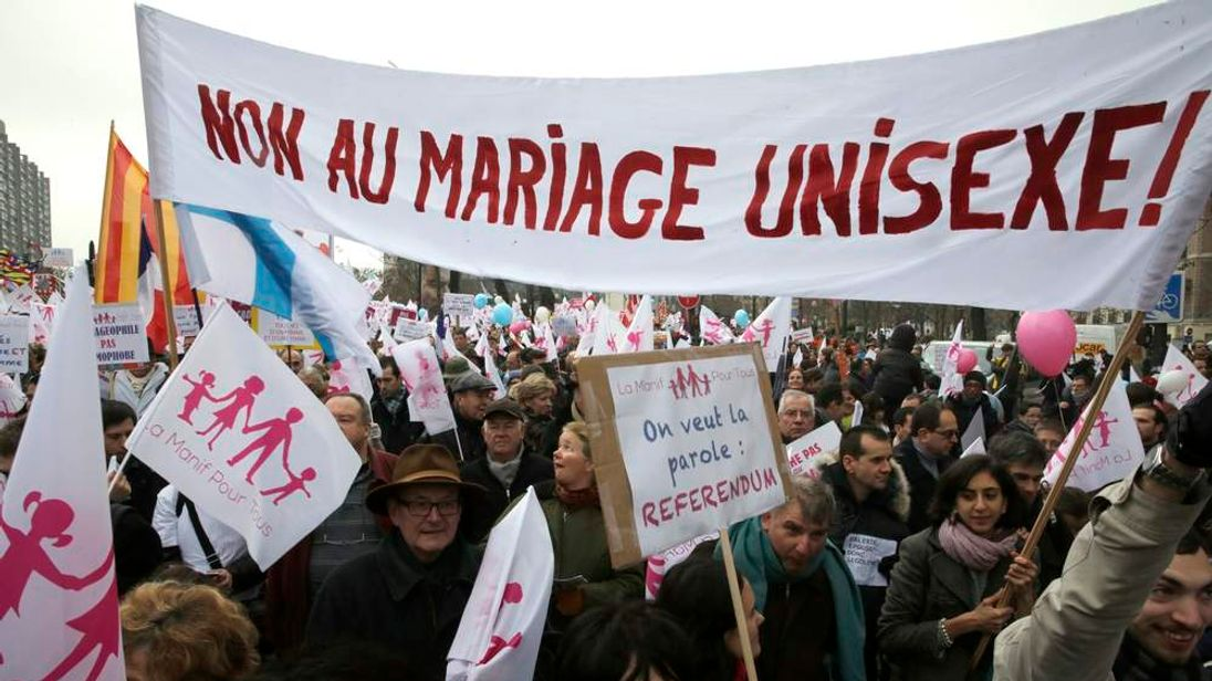 Demonstrators gather on Champ de Mars to protest France's planned legalisation on same-sex marriage in Paris