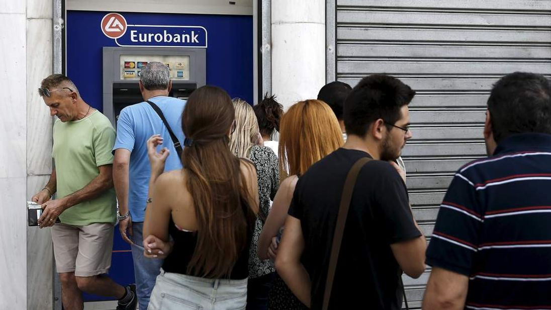Queue at cash machine in Greece