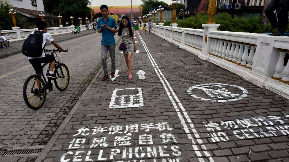Walking Lane For Cellphone Users In Chongqing, China