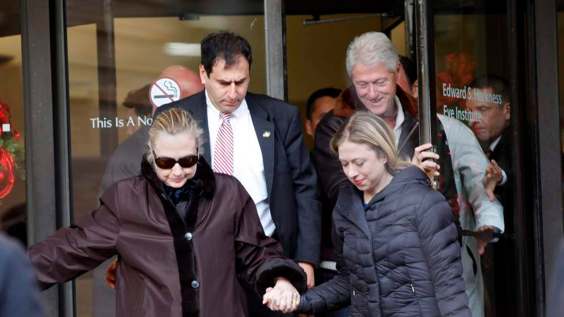 Hillary Clinton leaves a New York hospital with husband Bill and daughter Chelsea in New York in January 2013