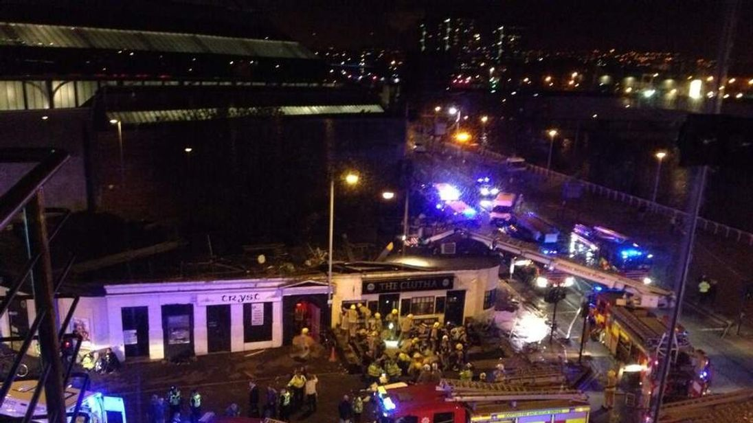 A helicopter has crashed into the roof of a Glasgow pub