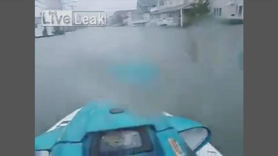Jetski travels in flooded streets in New Jersey after Superstorm Sandy