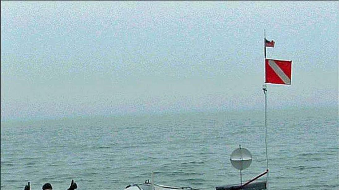 Jim Dreyer attempting long distance swim across Lake St Clair
