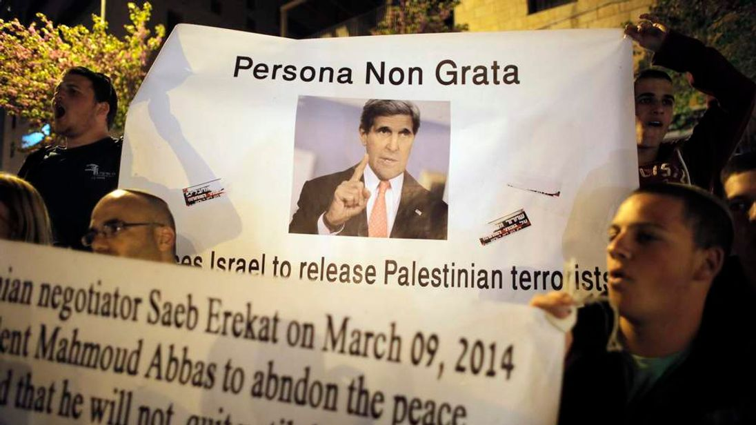 Israelis hold a sign depicting US Secretary of State Kerry during a protest in Jerusalem, against the release of Palestinian prisoners