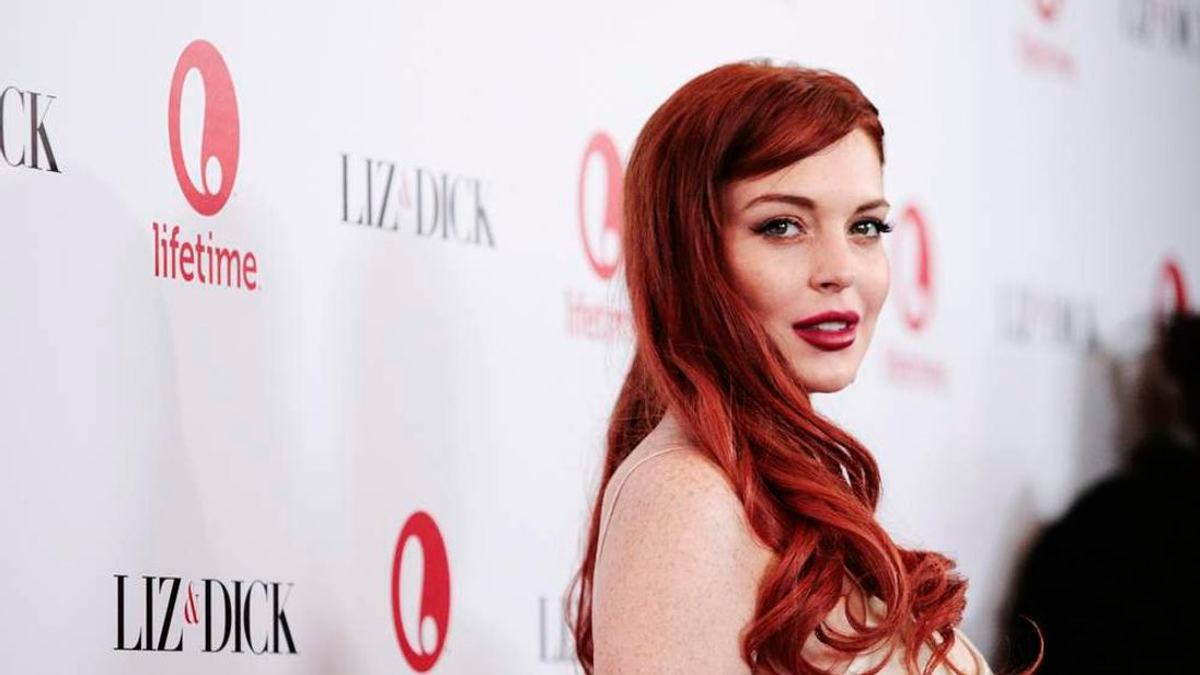 "Actress Lindsay Lohan arrives for a private dinner celebrating the upcoming premiere of ""Liz & Dick"" in Beverly Hills"