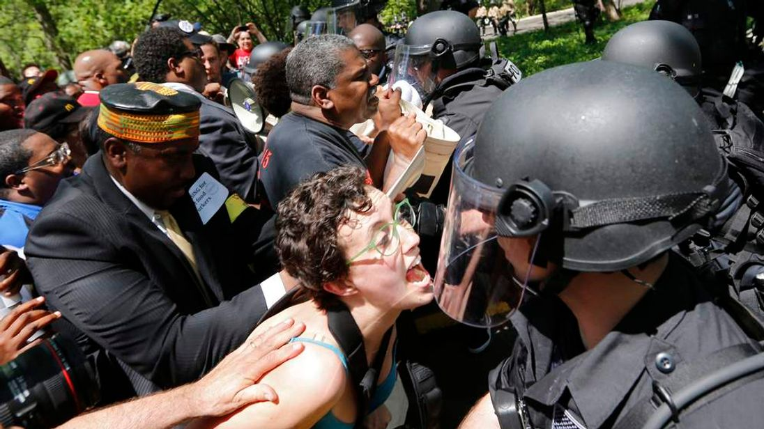 Demonstrators clash with police during a protest at McDonald's headquarters in Oak Brook, Illinois