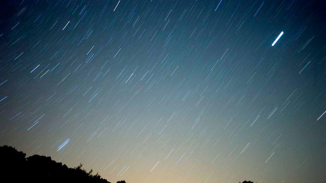 A meteor streaks across the sky