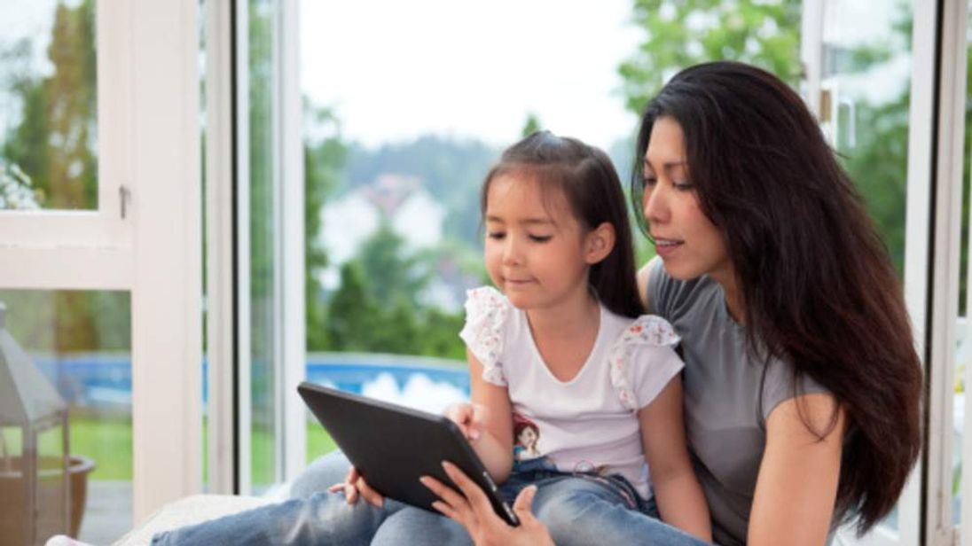 Mother and child with digital tablet