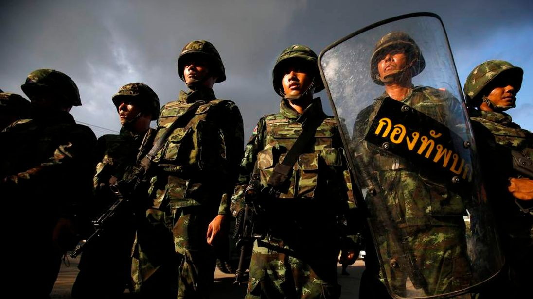 Thai soldiers stand guard during a coup at the Army Club where Thailand's army chief held a meeting with all rival factions in central Bangkok