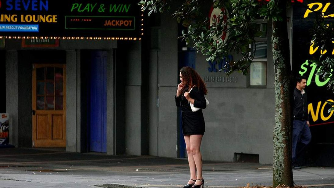 A prostitute works on Auckland's Karangahape Road