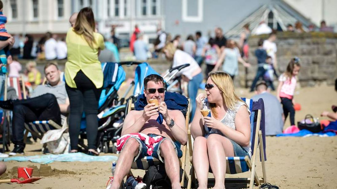 People eat ice creams in Weston-Super-Mare on Easter Monday