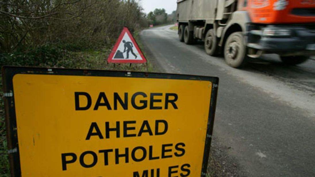 Potholes warning sign