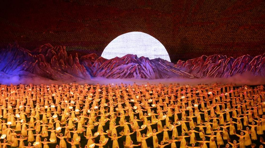 """North Koreans perform during a mass gymnastic and artistic performance """"Arirang"""" in Pyongyang"""
