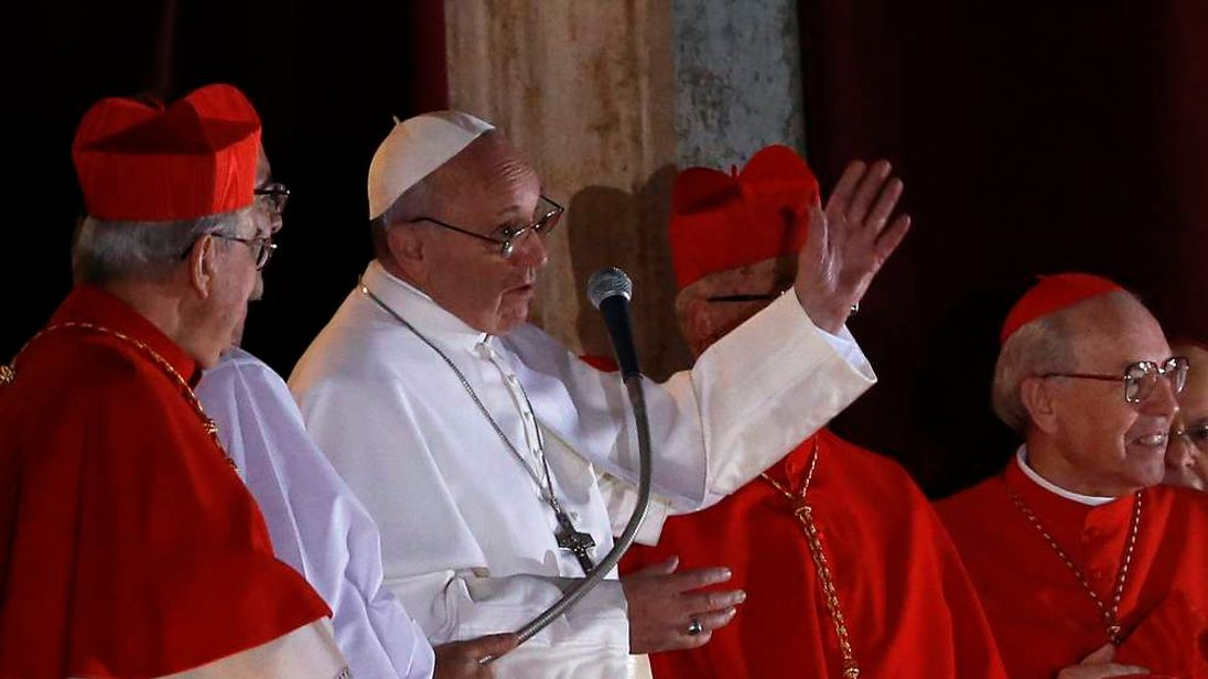 Newly elected Pope Francis appears on the balcony of St. Peter's Basilica after being elected by the conclave of cardinals, at the Vatican