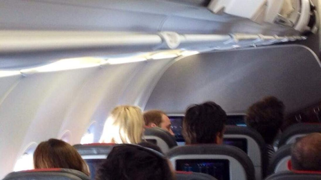 Prince William spotted flying economy class in US CREDIT: @Local24Eli / WATN-TV