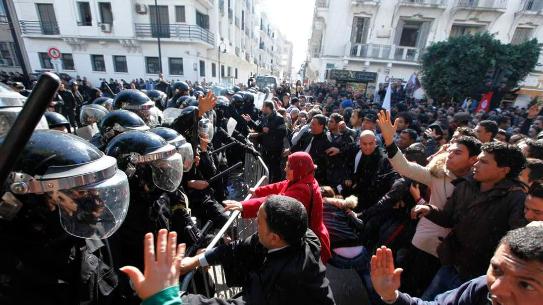 Tunisian protesters clash with riot police during demonstration after death of Tunisian opposition leader Belaid, outside the Interior ministry in Tunis