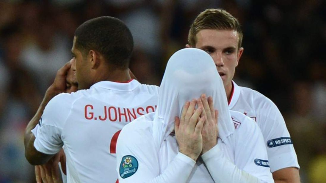 Wayne Rooney covers his face after the defeat.