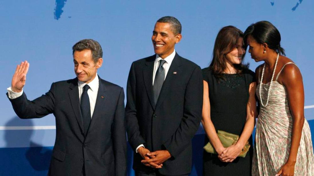 France's former President Sarkozy and his wife Carla Bruni-Sarkozy stand with US President Obama and first lady Michelle