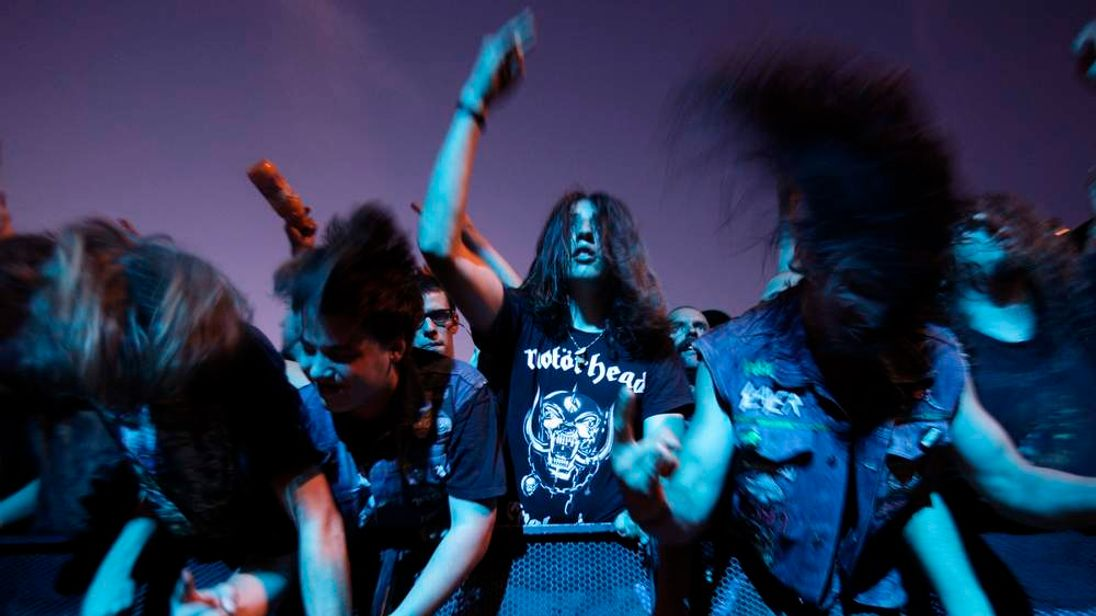 Fans of the band Motorhead headbang during their performance at the 35th Paleo music festival in Nyon.