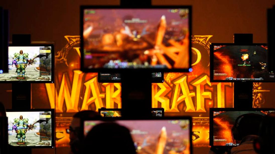 Visitors play ''World of Warcraft'' at an exhibition stand during the Gamescom 2011 fair in Cologne August 17, 2011.