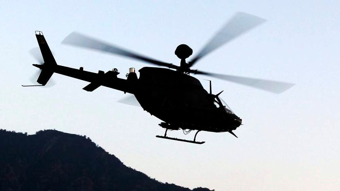 US Army Kiowa helicopter patrols over River Darya ye Kunar valley in eastern Afghanistan