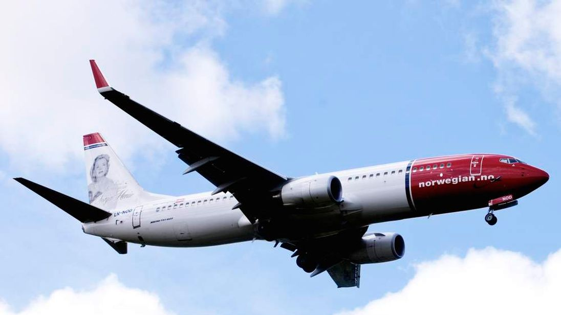 File photo of a Norwegian Air Shuttle Boeing 737-800 in the air near Oslo Airport