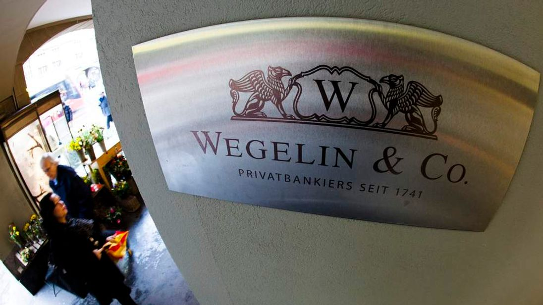A logo of the Swiss bank Wegelin is pictured at a building in Bern