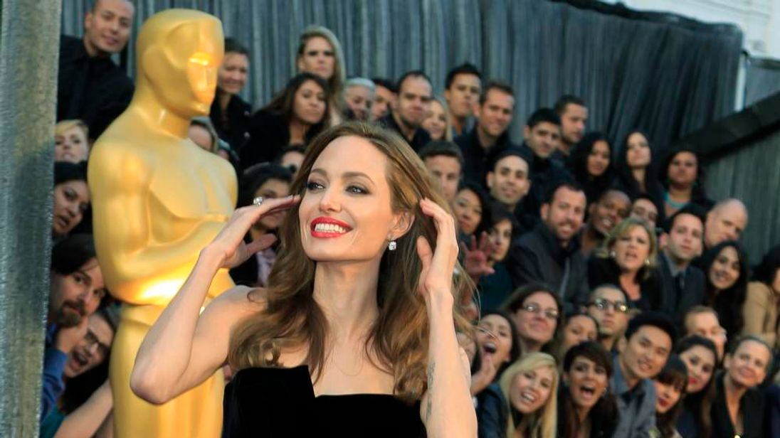 Actress Jolie poses at the 84th Academy Awards in Hollywood