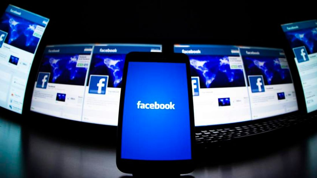 Facebook application on a mobile phone is seen in this photo illustration taken in Lavigny