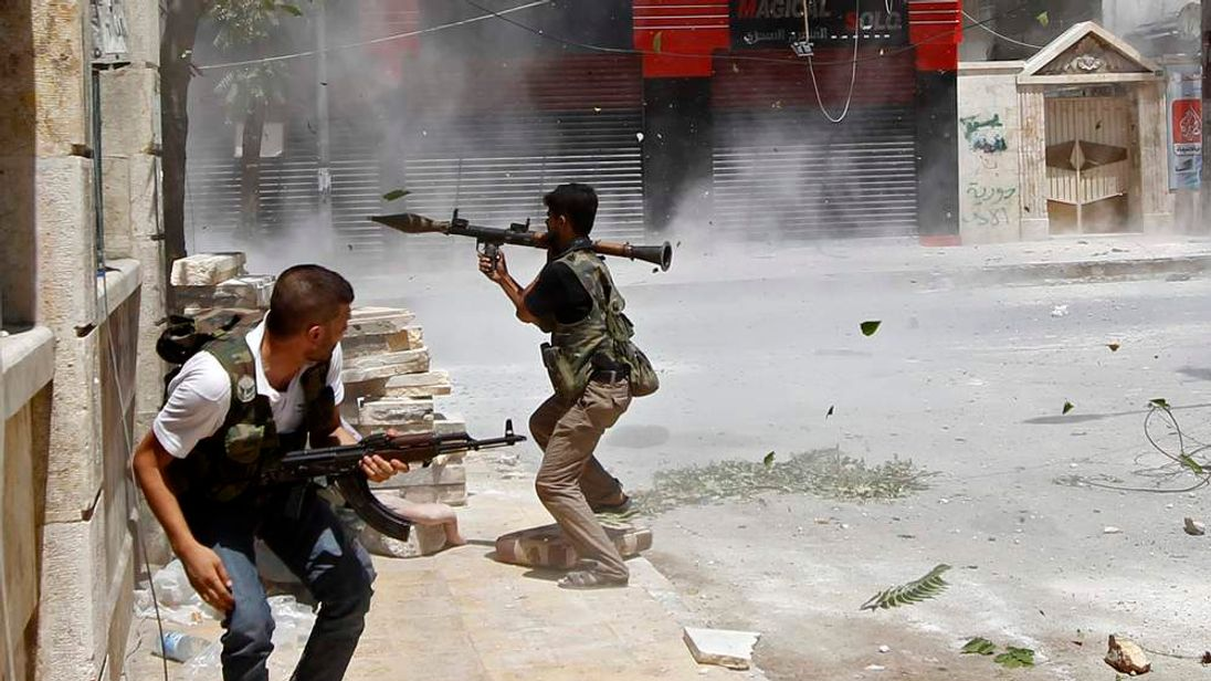A rebel fighter prepares to fire an RPG in Aleppo