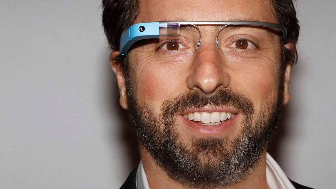 Google founder Sergey Brin wears Google Glass glasses