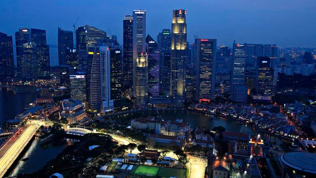 Skyscrapers of Singapore's central business district are pictured at dusk