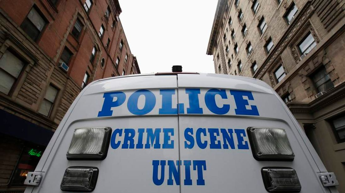 A NYPD Crime Scene Unit vehicle stands on West 75th street outside an apartment building where two children died in a stabbing, on New York City's upper west side of Manhattan