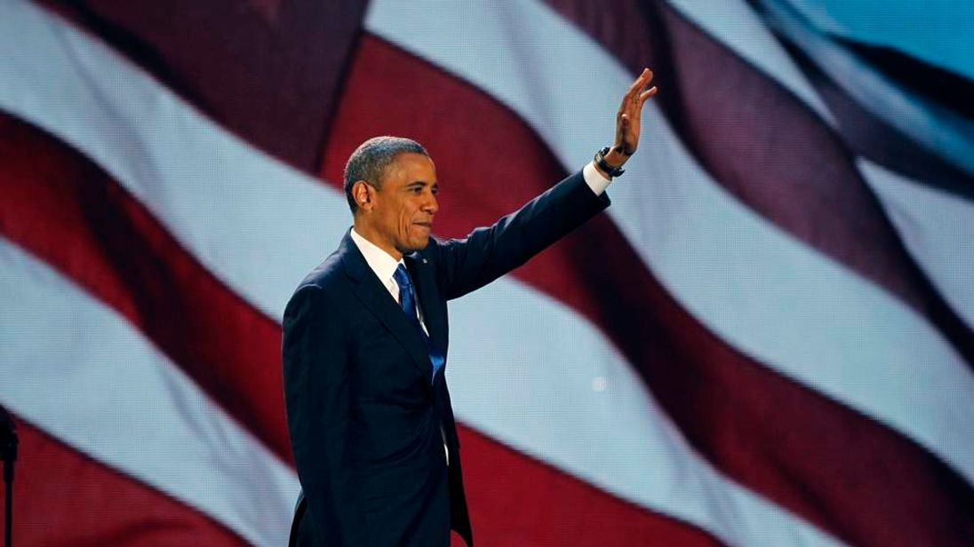 U.S. President Barack Obama waves as he addresses supporters during his election night victory rally in Chicago