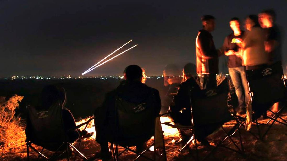 Israeli civilians watch rockets fly towards southern Israel