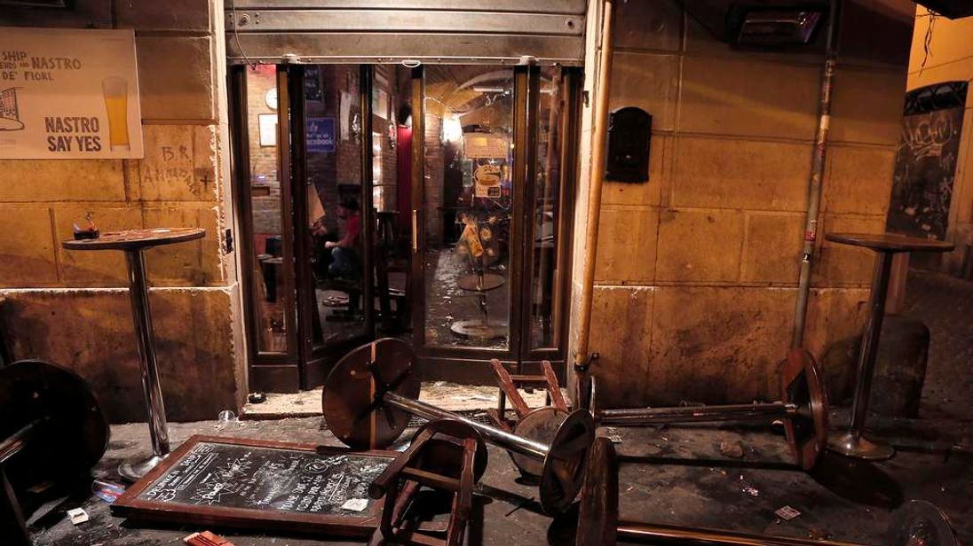 A pub is seen damaged after a fight in downtown Rome